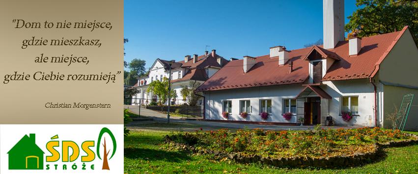 Po lewej stronie znajduje się motto ŚDS oraz logo. Po prawej stronie budynek ŚDS oraz piękny klomb z kwiatami.
